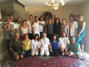 Acharya M. Govindan Satchidananda (kneeling, center), and to is right Acharya Shantiananda, along with participants                in the 2nd initiation and retreat in Redlands, California, July 29-31, 2016