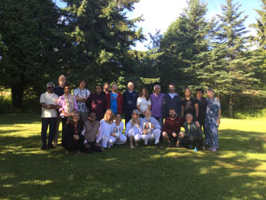 Participants in the 3rd initation, July 15-24, 2016 at the Quebec ashram with (kneeling, in white) Acharyas                Siddhananda Sita, Sharanadevi, Durga and M. G. Satchidananda